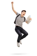 Overjoyed teenage student jumping and gesturing happiness