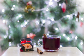 Christmas cosy decoration with mulled wine and cinnamon