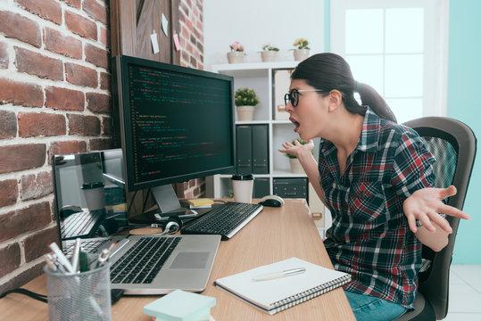 beautiful programmer woman looking at computer