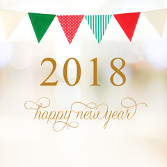 Happy New Year 2018 on abstract blur festive bokeh and party bunting flags background, banner