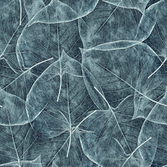 seamless background from light cyan leaves