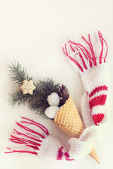idea of winter ice cream/ waffle horn with spruce branch, cone and figured cookie in scarf