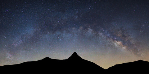 Panorama landscape with Milky way galaxy bridge over high moutain