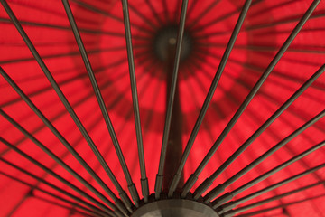 Red Umbrella With Black Metal Poles Outside