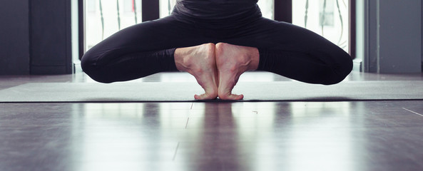 Closeup of male palms and feet, men practicing yoga at home, stretching in Ustrasana exercise, close up, floor mat background