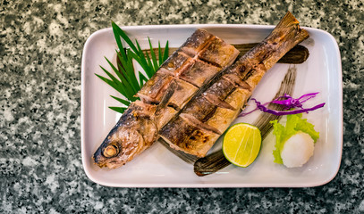 Japanese Style Grilled and Salted Barracuda Fish Served with Lime and Grated Radish.