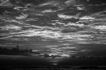 tropical sunset at the Indian ocean - black and white - dark tones, high contrast