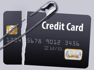 The idea of repairing your credit is illustrated with safety pins holding together a broken credit card. Isolated on background.