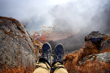 Hiker Boots Relax on Mountain Peak with Mountain Lakes in background