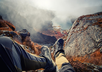 Hiker Boots Resting on Mountain Peak with Mountain Lakes in the Background