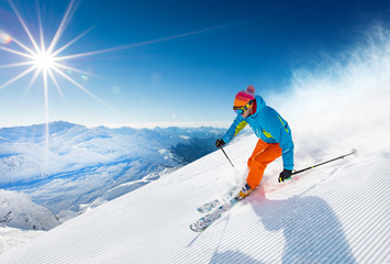 Poster Winter sports Skier skiing downhill in high mountains