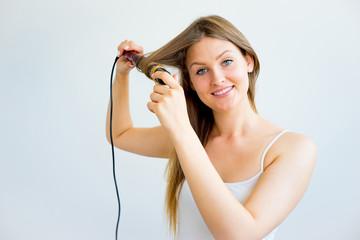 Girl taking care of her hair