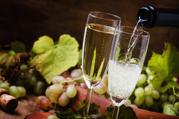 Champagne Pour In Glass, Grapes With Vine, Vintage Wood Background, Selective Focus