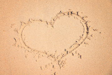 love, drawing on pure sand