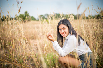 Sad asian woman smiling at field vintage style,she very happy from love