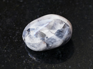 tumbled Tamerlane Stone (amethyst quartz) on dark