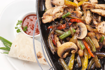grilled meat with mushrooms and vegetables