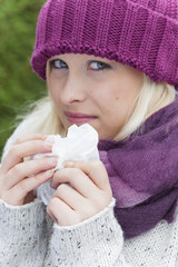 woman has runny nose and has a cold