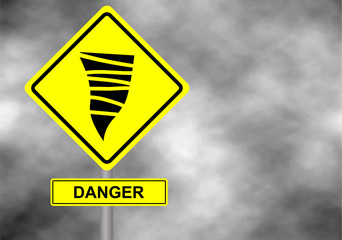 Danger tornado road sign . Yellow hazard warning sign against grey sky - tornado warning, bad weather warning, vector illustration. Hurricane season with symbol sign against a stormy background.