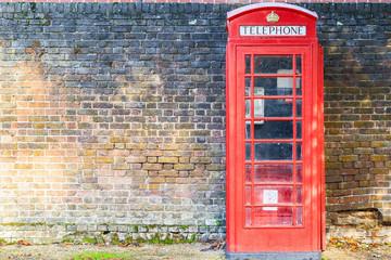 Red telephone box on street of Hampstead Heath in London