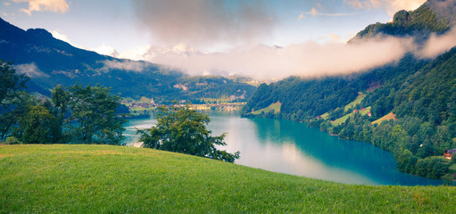 Foggy summer panorama of Lungerersee lake