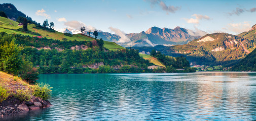 Misty summer panorama of Lungerersee lake.