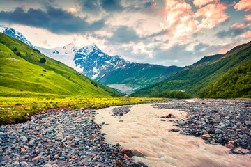 Colorful summer sunrise in the mountain valley with Adishchala river