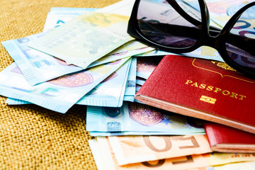 Passports with european union currency and sunglasses on a map background. Travel concept.