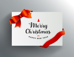 Christmas greeting card with Merry Christmas wishes and red ribbon.