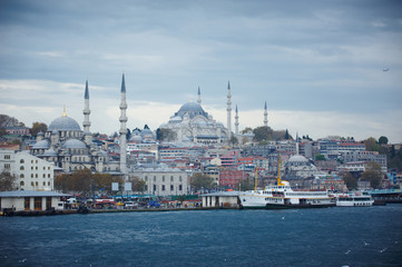 Istanbul cityscape with boats and Suleymaniye Mosque, Turkey.