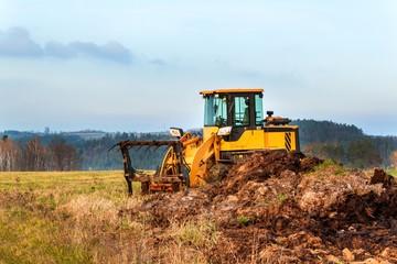 Dredger with natural manure loading trailer for field fertilization. Agricultural machine for fertilizing. Cow Dung.