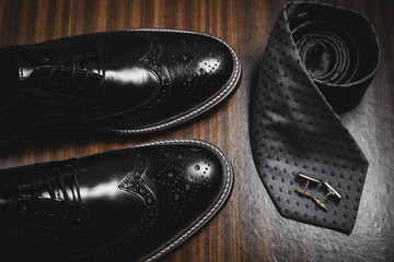 Male accessories. Shoes with tie and cuff
