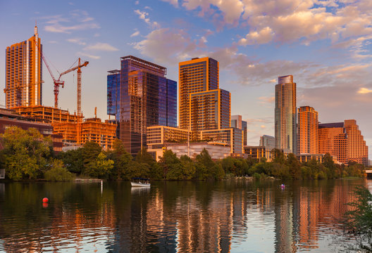 Austin, Texas with new buildings rising, reflecting in lady Bird Lake during sunset / Austin Skyline and new constructions