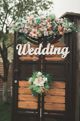 Wooden plaque with the inscription Wedding. Decorations