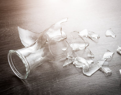 Broken bottle glass on wooden floor