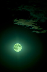 full green fantastic moon in the sky with clouds, moonlight.