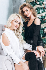 Beautiful women in new year interior. Christmas and New Year concept