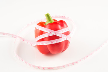 Red paprika with measuring tape