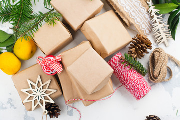 Many Christmas gift boxes. Christmas presents ready for wrapping with decor on white holiday background. Copy space