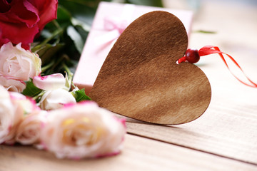Roses and wooden heart shape