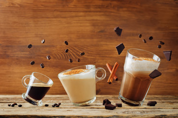 Different types of coffee with flying ingredients. Espresso, cappuccino and mocha coffee