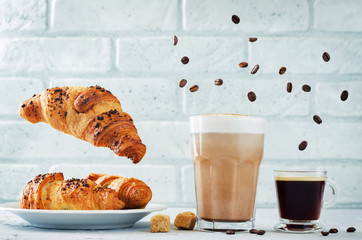 Different types of coffee with flying croissants. Espresso and mocha coffee