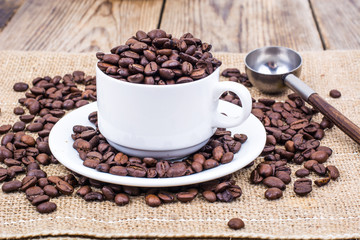 Cup full of coffee beans