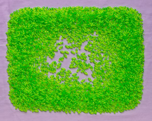 Background of many plastic green plastic beads.