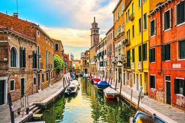 Venice rio San Barnaba cityscape, water canal, church and boats. Italy