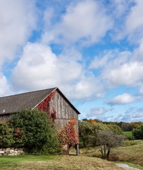 Weathered old barn on country hillside
