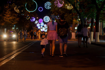 Family in the street of the night city