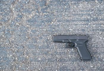 Gun Lays in the Street