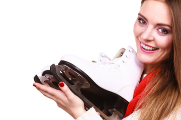 Attractive girl with ice skates.