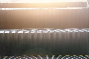 Closeup Escalator ladder with sunlight for Next Step to Business Success Concept